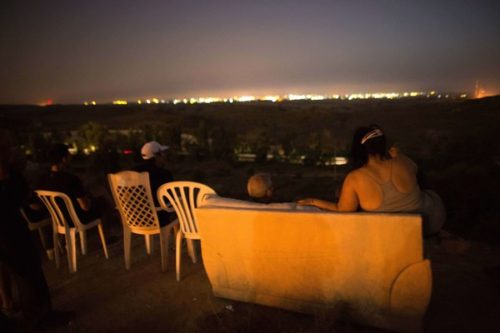 "Jews laugh, eat, and drink as they view the bombing of Gaza from a nearby hill. Clearly, they have no fear of ""Palestinian rockets."""