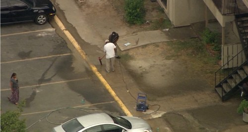 """HAZMAT cleanup crew"" hard at work cleaning up Patient Zero's bodily fluids at his apartment complex. This is not Monrovia, Liberia. It is Dallas, Texas."