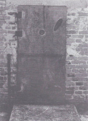 """A casting of this """"gas chamber"""" door from the Majdanek camp in Poland is on display at the US Holocaust Memorial Museum in Washington, DC. French Holocaust researcher Jean-Claude Pressac has conceded that this """"gas chamber"""" is a fraud. (See the Sept.-Oct. 1993 Journal, p. 39.)"""