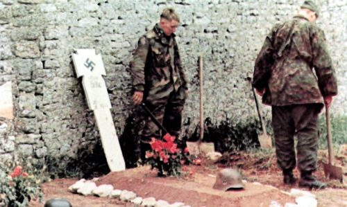 Men-of-SS-Panzergrenadier-Regiment-25-erect-temporary-grave-crosses-e1469363427753