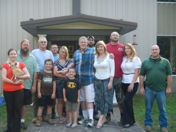 Eighteen members and supporters, some shown here, gathered to enjoy late Summer camaraderie and a cookout on our West Virginia campus (Will and Svetlana Williams, center; Laura Lee and David Pringle, far left). The occasion was our celebration of the birth of the founder of the National Alliance, William Pierce.