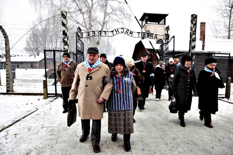 Holocaust survivors arrive for a ceremony to mark the 69th anniv