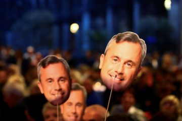 Supporters of Austrian far-right Freedom Party presidential candidate Norbert Hofer hold masks with Hofer's face during a September rally in Vienna.