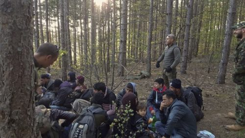 Members of the Organization for Protection of Bulgarian Citizens in April leading a group of migrants from Afghanistan near Bulgarian border with Turkey.