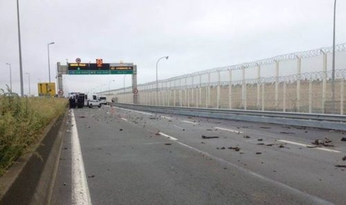 Debris ... Crowd threw stones at police protecting Calais port