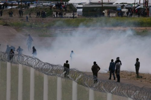 Tear gas ... An approach road to Calais port where riot police used tear gas on violent mob