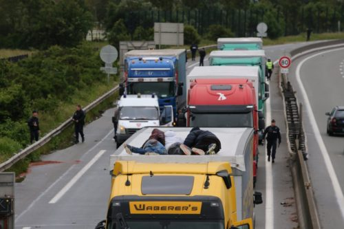 Three men lie on top of the HGV