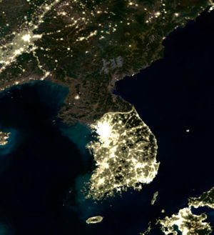 North and South Korea at night. The splash of light in the lower right is southwestern Japan. The lights to the north are in China (Manchuria). The speck of light near the country's west coast is the capital, Pyongyang.