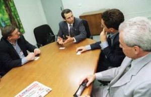 Israel's ambassador to Brazil, Eitan Surkis, meets with reporters.