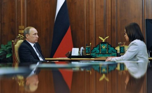 Russia's President Vladimir Putin (L) speaks with the Central Bank Governor Elvira Nabiullina during their meeting at the Kremlin in Moscow on August 10, 2015. Russia's central bank chief insisted today that the country's beleaguered banking system is out of danger after being battered by the economic crisis rocking the country. Russia entered its worst financial crisis of Putin's 15-year rule in December as plummeting oil prices and Western sanctions over the conflict in Ukraine sent the economy into a nosedive.