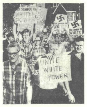 Angry White youths confront Black marchers on August 14, 1966.