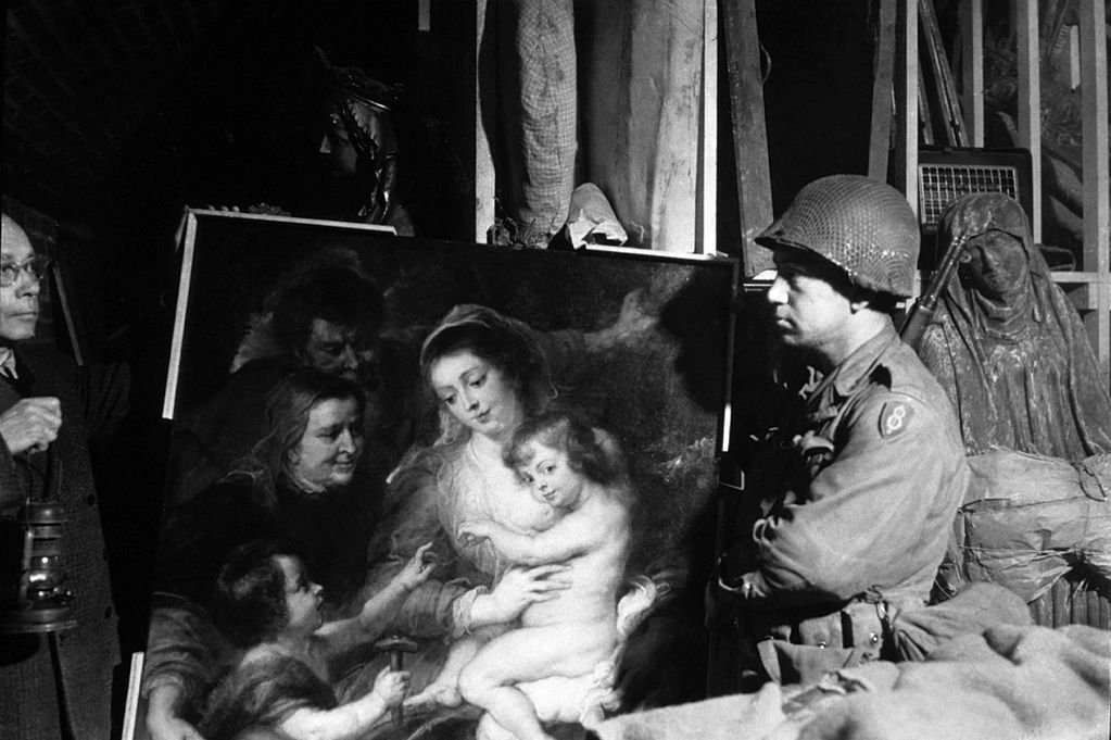 a-us-soldier-inspects-priceless-art-taken-from-the-jews-by-the-nazis-and-stashed-in-the-heilbron-salt-mines