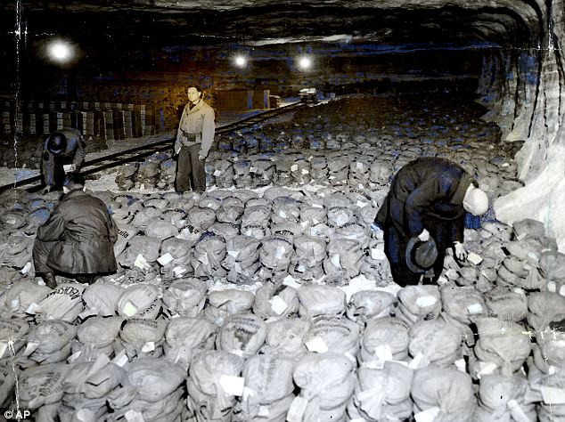 Liberated from the clutches of the high interest Western banking elites Hitler's Third Reich soon became wealthier than the United States of America. When discovered by the invaders the Reich's gold and silver reserves were shipped to American banks. Here we see troops from General Patton's Third Army stand among gold reserves hidden in a salt mine.