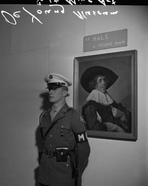 A U.S Military Policeman makes certain that this American looted painting by German artist Franz Hals was not going to be stolen.