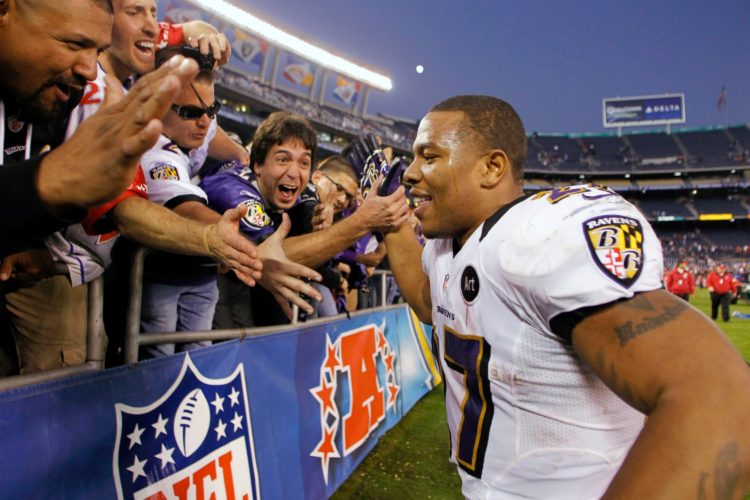 "Football fans worship their Negro ""hero"""