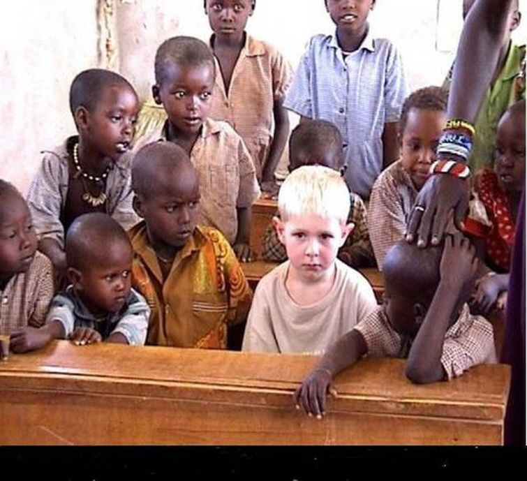 Black boys crowd around lone blond boy The End of the NFL https://nationalvanguard.org/wp content/uploads/2017/02/Black boys crowd around lone blond boy.jpg