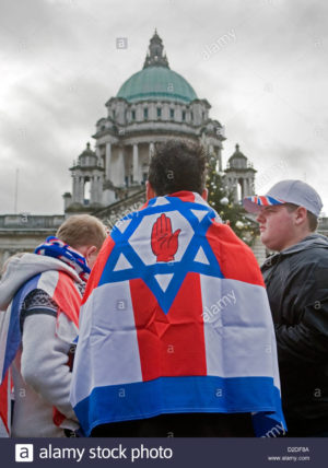young-man-with-flag-depicting-the-star-of-david-the-red-hand-of-ulster-D2DF8A.jpg